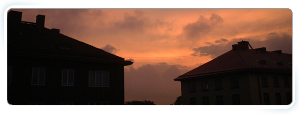 Our Care Homes banner - 2 houses at dusk